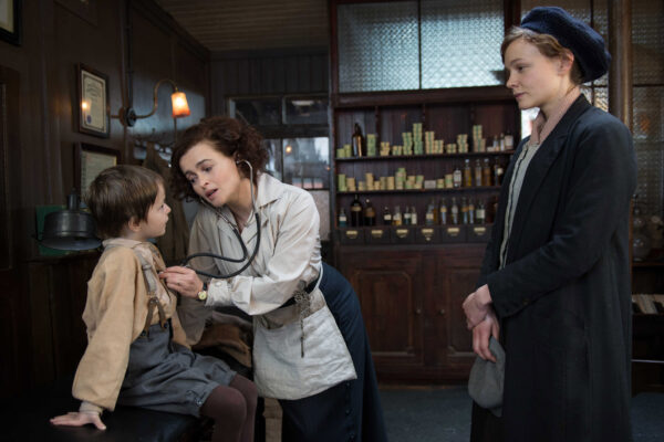FILM STILL: SUFFRAGETTE. (L to R) Adam Michael Dodd as George Watts, Helene Bonham Carter as Edith Ellyn and Carey Mulligan as Maud Watts in director Sarah Gavron's SUFFRAGETTE, a Focus Features release. Credit : Steffan Hill / Focus Features